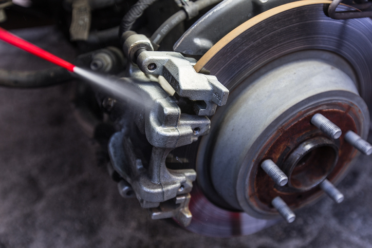 Cleaning car brake pad and disc with caliper