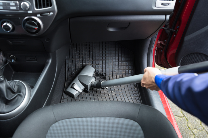 Handyman's Hand Vacuuming Car Mat