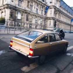 Old car driving and polluting Paris
