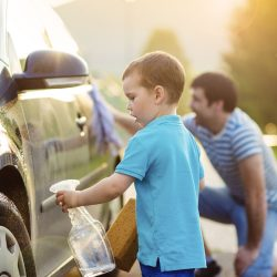 Father and Son Cleaning Car