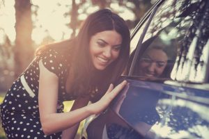 excited woman with car