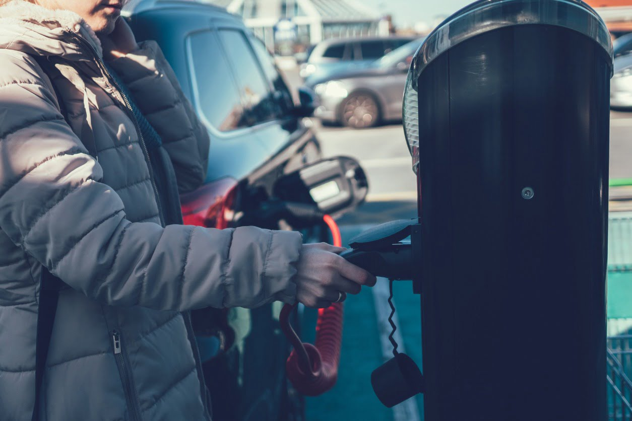 woman at electric charger