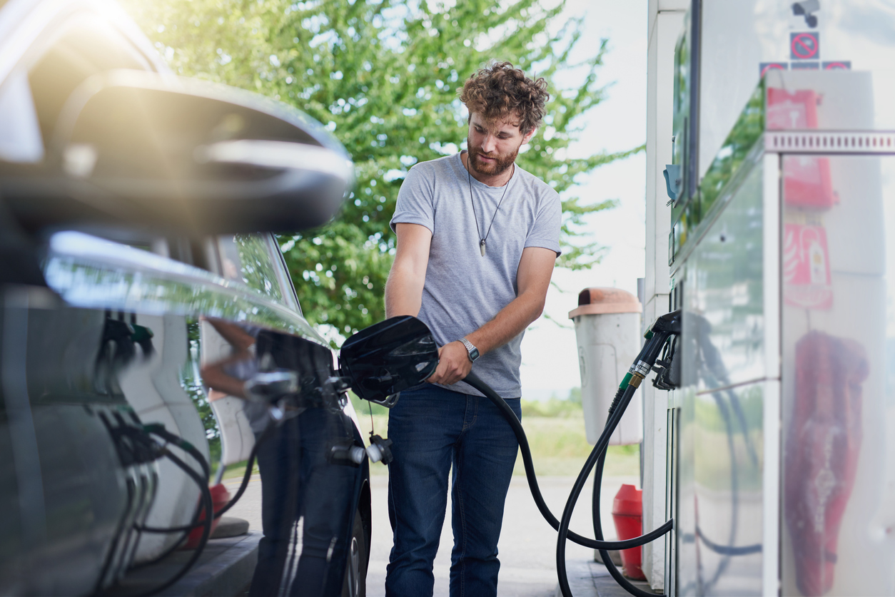 man filling up car with petrol