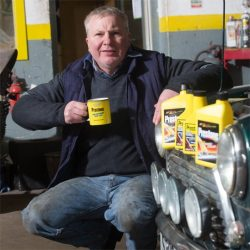 Mechanic with Prestone Mug and Products