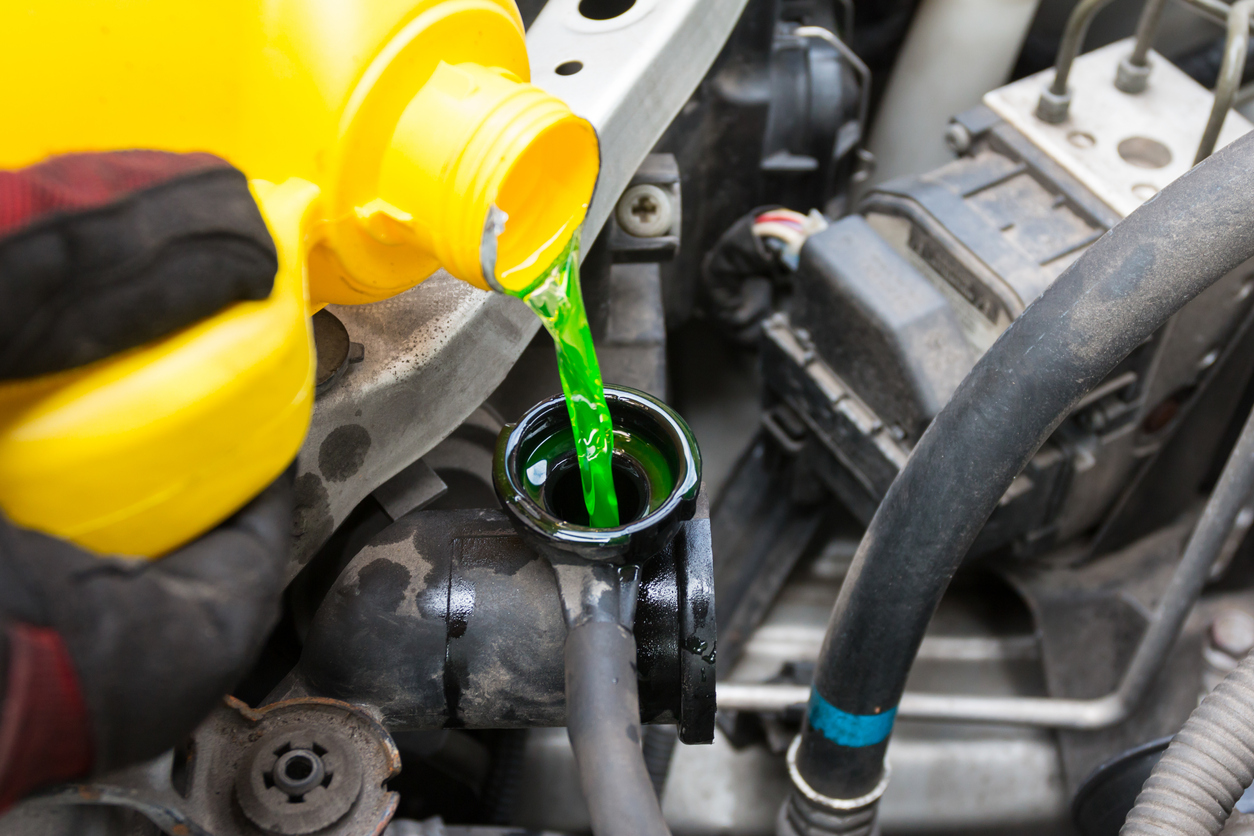 pouring engine coolant