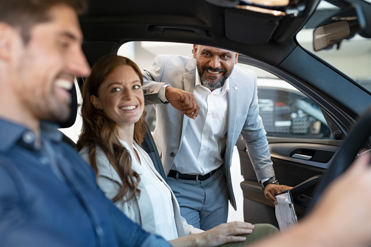 couple smiling in new car