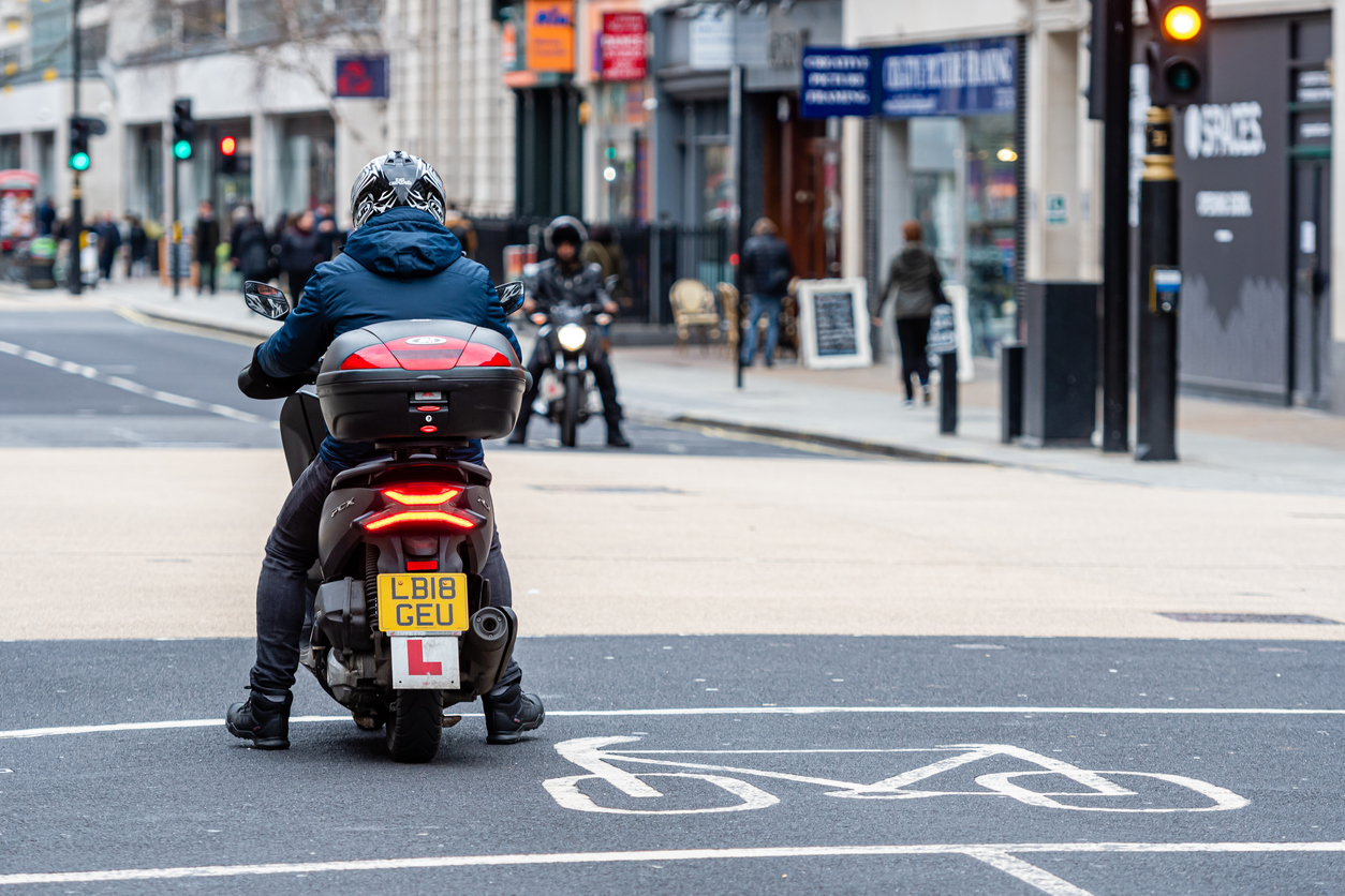 learner driver on moped