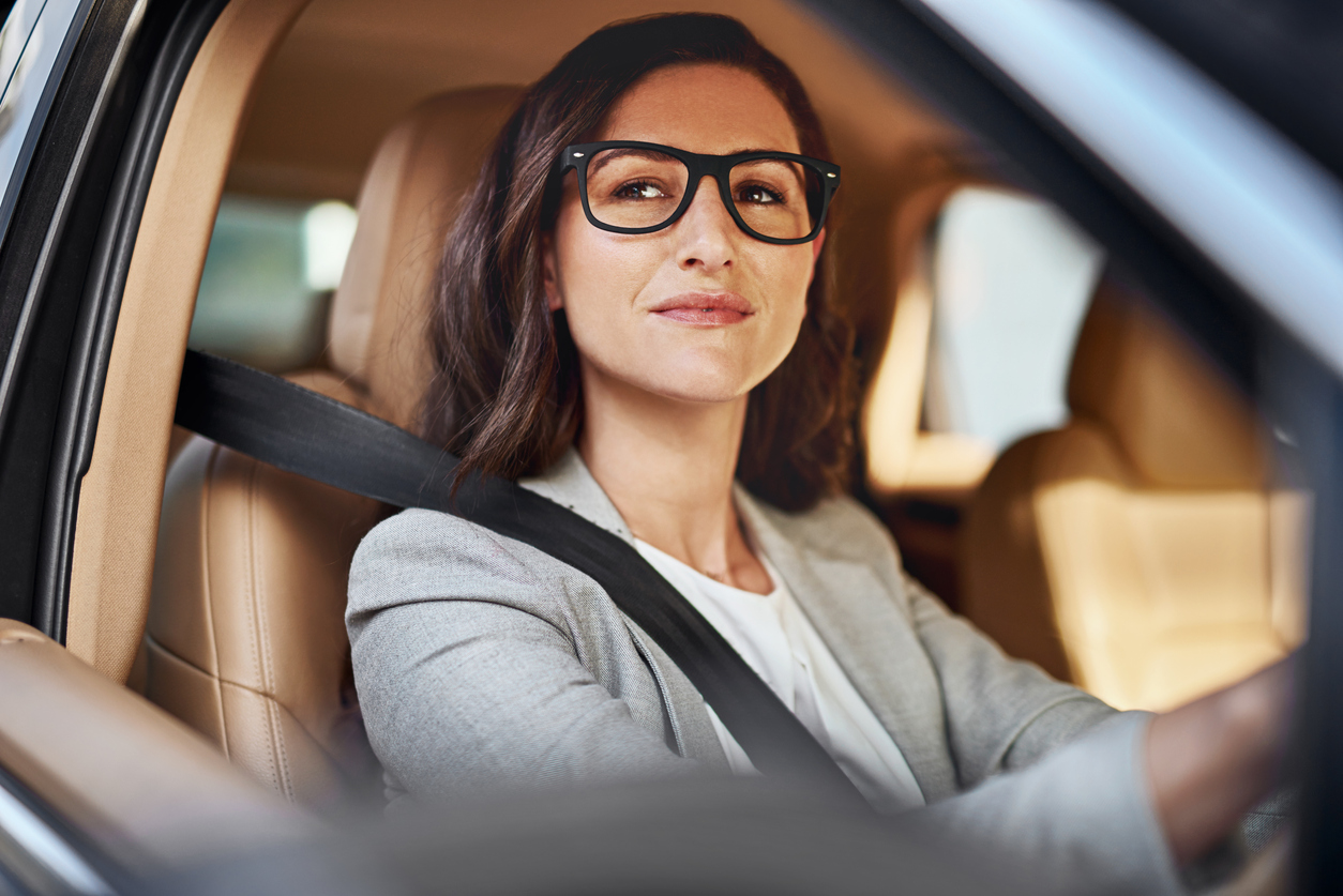woman wearing glasses driving