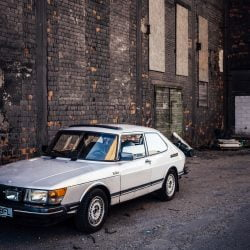 Saab 900 Turbo parked near the wall of old abandoned chemical factory