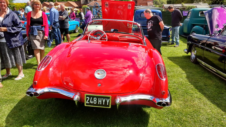 Skeyton, Norfolk, England – May 27 20018: Special limited edition British made open top sports car in fire red. Just one fine example of a classic car in a rally of many others in an annual event in this quiet English village.