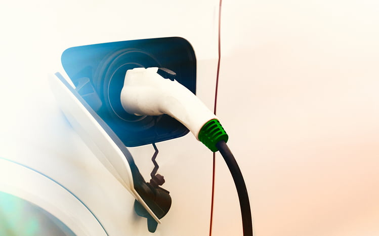 Close up view of Electric Car charging with copy space
