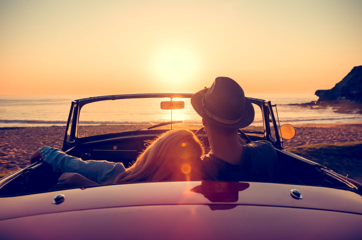 classic car at sunset couple
