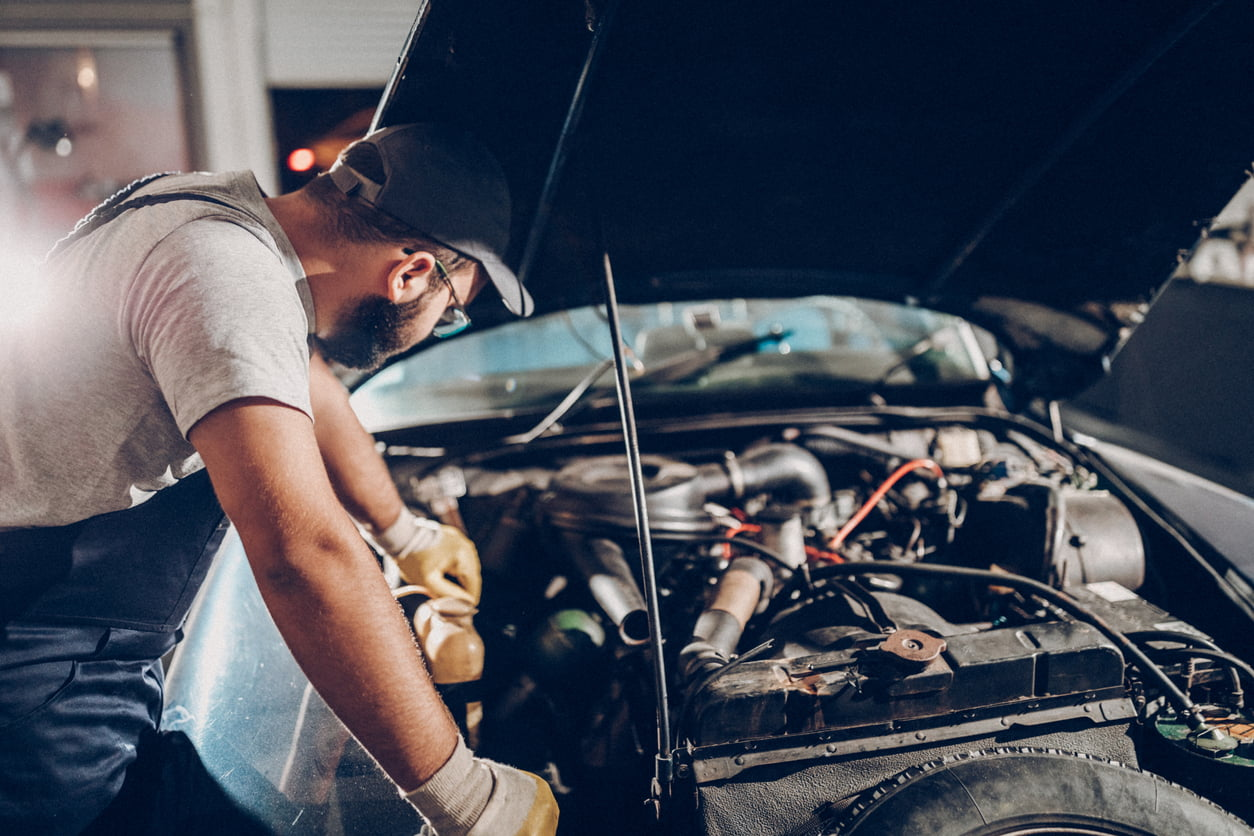 mechanic looking at engine
