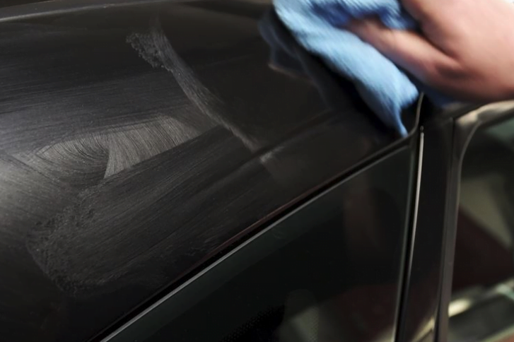 Car being waxed