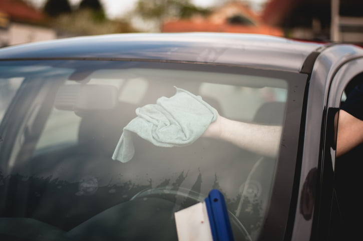Car windscreen being washed