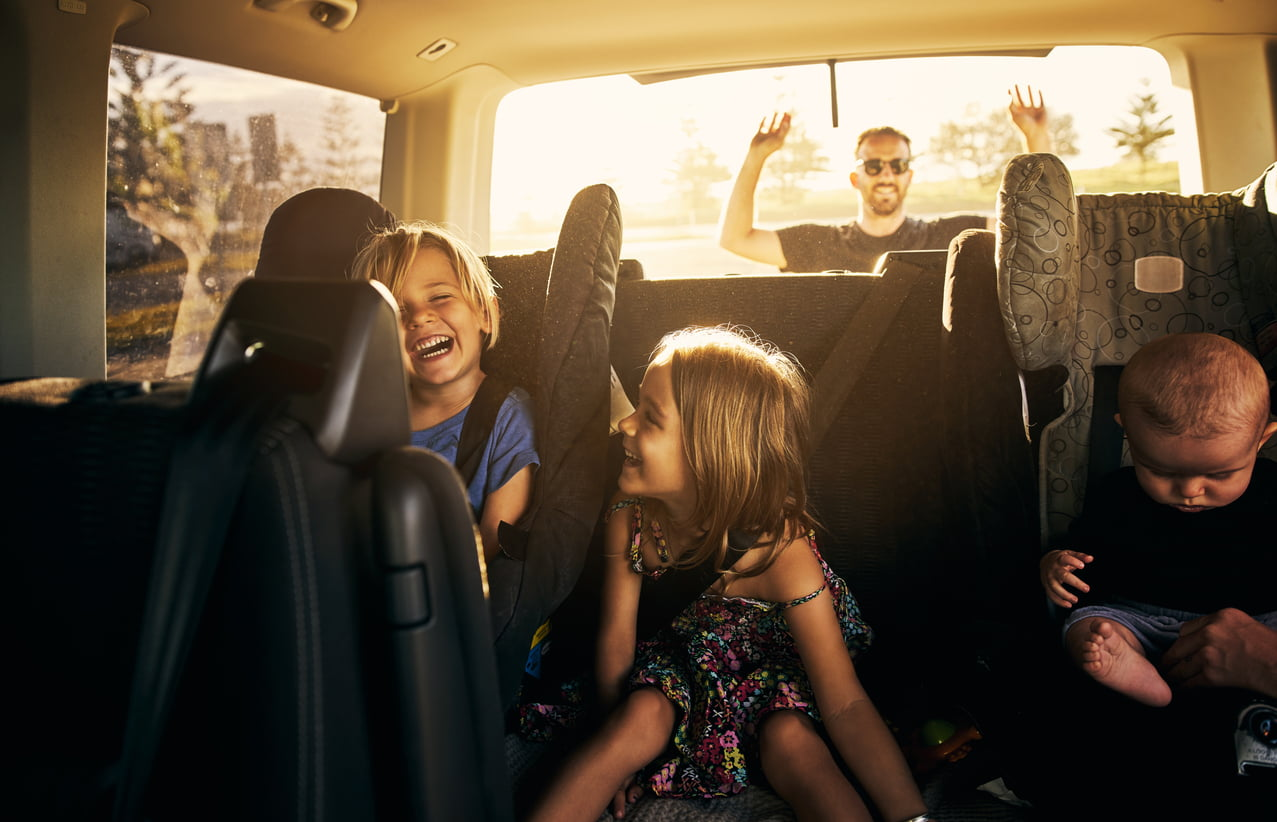 image of happy family in car