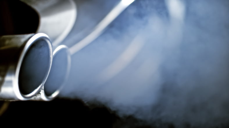 Smoke emission from exhaust pipe of car.