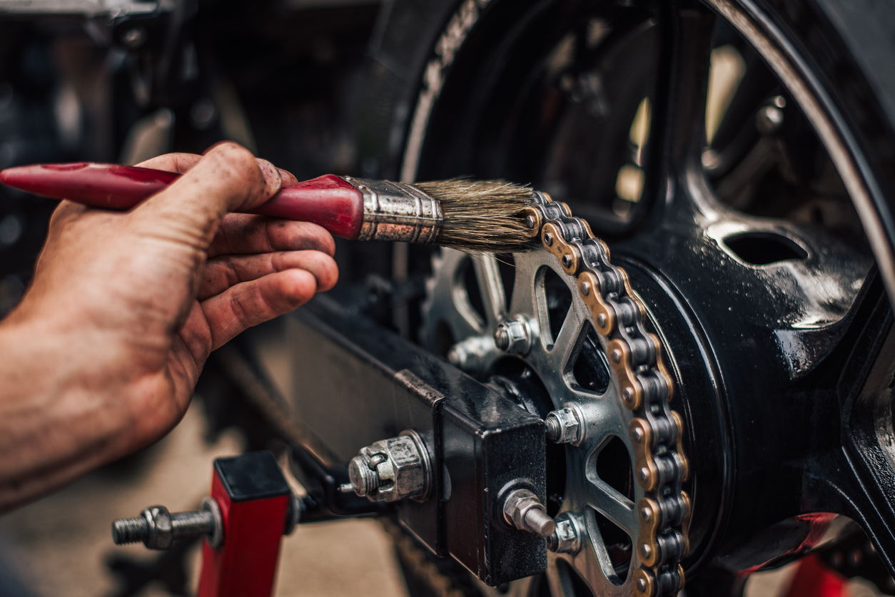 oiling the chain on motorcycle
