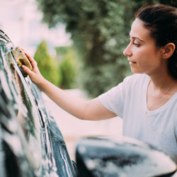 woman cleaning her car windows