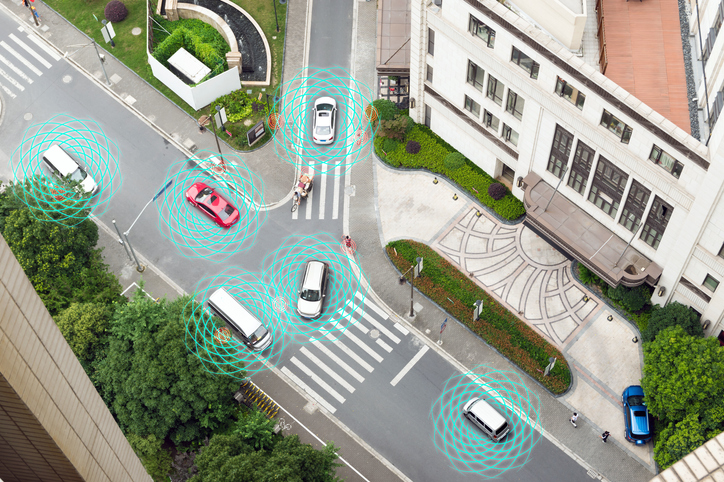 Smart car (HUD) , Autonomous self-driving mode vehicle on metro city road iot concept with graphic sensor radar signal system and internet sensor connect. Above view.