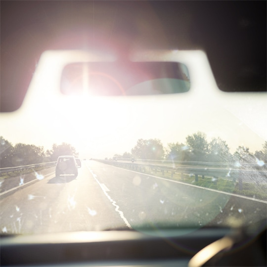 Dangerous sun dazzle - dirty windscreen with glare
