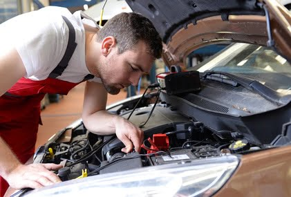 professional auto mechanic repaired in car workshop