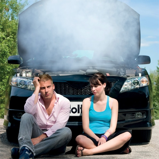 Couple with broken down car - smoke from bonnet