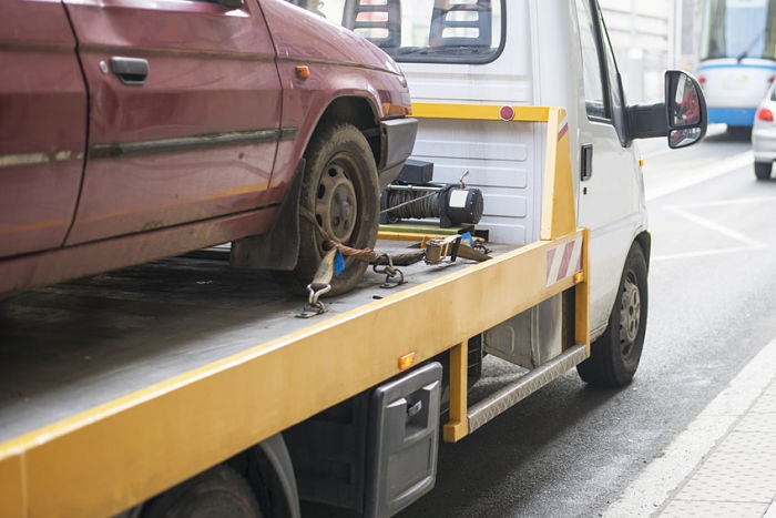 Roadside assistance car towing truck in the city